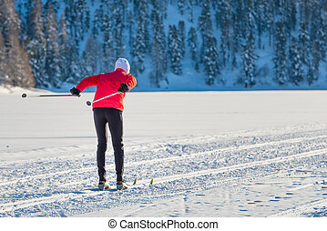Cross-country skier on track pushes shoe