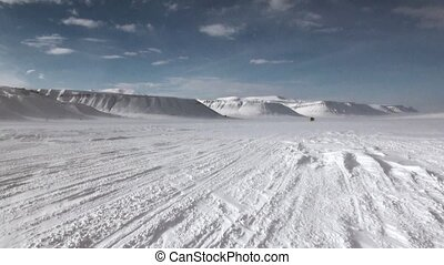 Cross-country vehicle in North Pole Spitsbergen Svalbard Arctic. Way from airport Longyear to Pyramiden on background of glacier.