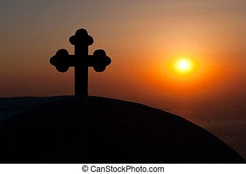Cross during sunset