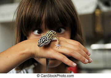 Cross-eyed child and gecko