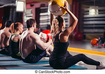 workout group woman and man at gym