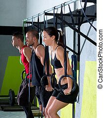 Cross fit dip ring group workout dipping in a row