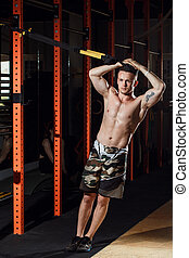 Cross fit fitness TRX push ups man workout at gym