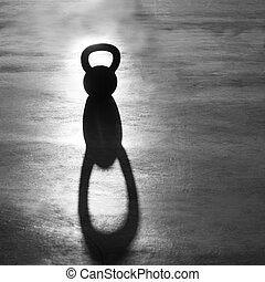 Cross fit Kettlebell weight backlight and shadow on the gym floor