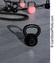 Cross fit Kettlebells ropes in fitness gym