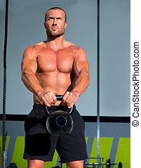 Cross fit Kettlebells swing exercise man workout