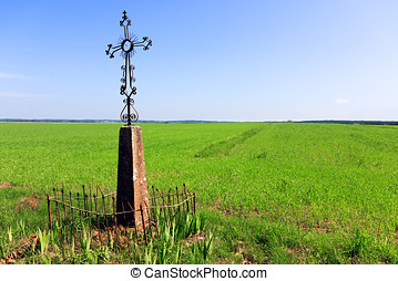 Cross in a field