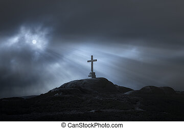 Cross in an overcast full moon night