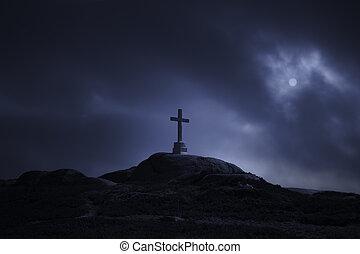 Cross in an overcast full moon night