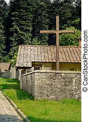 Cross in front of monastery building