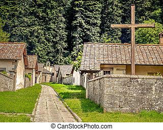 Cross in monastery settlement, Italy