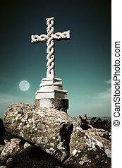 Cross in moonlight