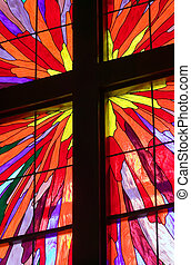 Cross in Stained Glass Window - A portion of a stained glass...