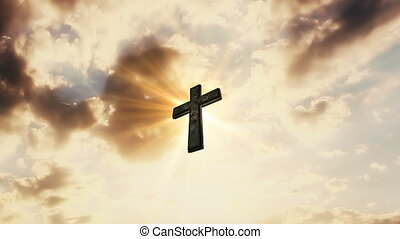 Cross In The Sky With Moving Clouds and Sun Rays Behind It. Catholic Religion Concept