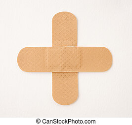 Cross made of plasters isolated on white
