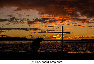 Cross Of Prayer - Man praying at a cross with a colorful...