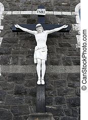 cross of the crucifiction on a wall - a cross of the...