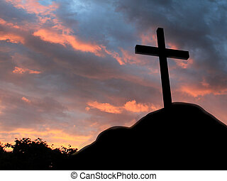 Cross on a hill with cloudy background