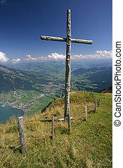 A wooden cross standing on top of Rigi mountain in Switzerland.