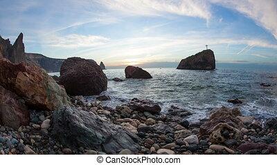 Cross on a rock in the sea