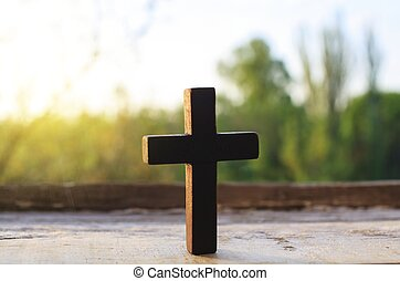 cross on a wood background