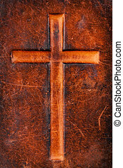 Cross on leather - Cross symbol on a brown leather texture