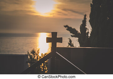 cross on the roof at sunset time