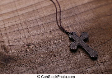Cross On The Wooden Background