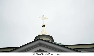 Cross on top of the dome in church