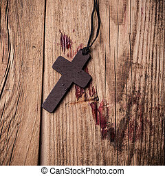 Cross on wooden background