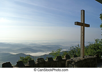 Cross overlooking the mountains in a church.