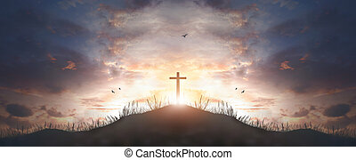 cross religion symbol silhouette in grass over sunset  sky cross religion symbol silhouette in grass over sunset or sunrise sky