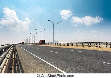 cross-sea bridge against a blue sky
