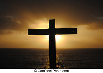 Cross, sea, sunset