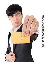 cross shape - Asian businessman holding a card written on x...