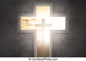 Cross shape with christ symbol at sunset background
