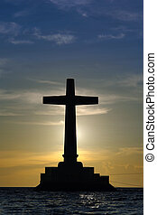 Cross silhouette over sunset