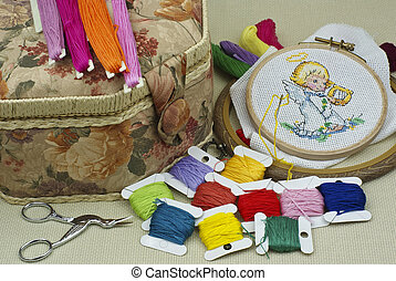 Cross-stitch - The embroidered angel on an outline with...