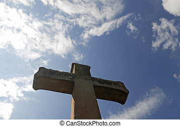 Cross in front of a grave.