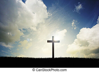 Cross sunset - Cross on a hillside with sunset in the...