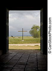 Cross Through Doorway. - A cross as viewed through the...