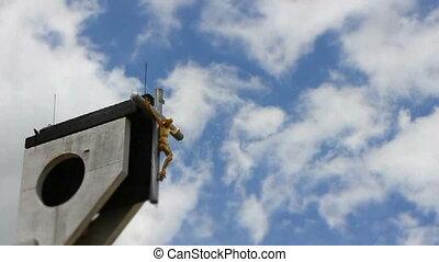 Cross with Jesus on Blue Sky