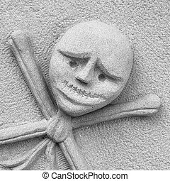 Crossbones carved in a tombstone