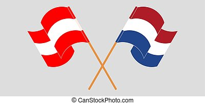 Crossed and waving flags of Austria and the Netherlands. ...