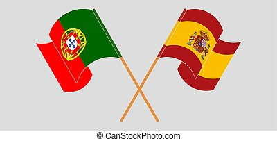 Crossed and waving flags of Portugal and Spain