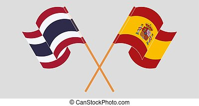 Crossed and waving flags of Thailand and Spain