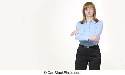 crossed arms. strong position. girl in pants and blous.  Isolated on white background. body language. women gestures. nonverbal cues