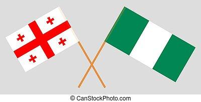 Crossed flags of Nigeria and Georgia