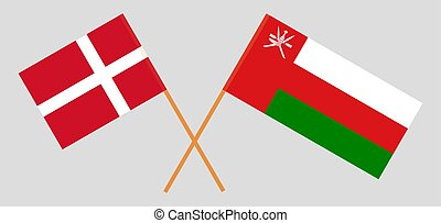 Crossed flags of Oman and Denmark