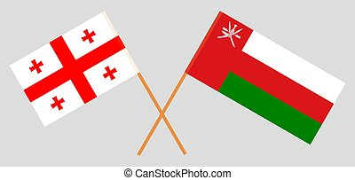 Crossed flags of Oman and Georgia